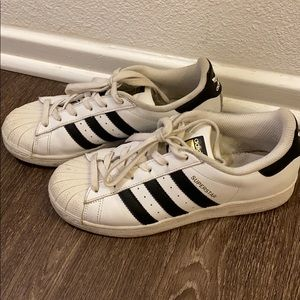White with black stripes Adidas Superstar sneakers